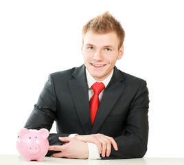 Young man with piggy bank (money box)