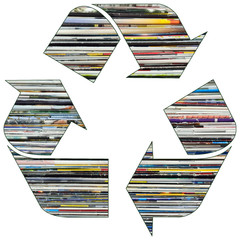 Recycle symbol with old magazines