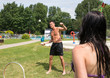 Couple playing badminton at swimming poot or park