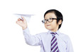 Confident business boy holding paper plane - isolated