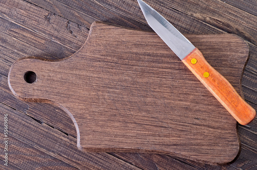 knife on wooden board
