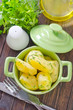 boiled potato in green bowl