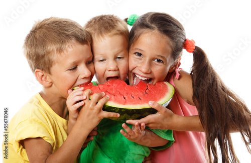 Happy family eating watermelon