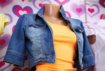 Clothes on mannequin in shop, close up
