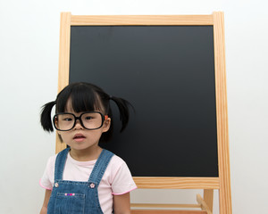 Little kid with blackboard