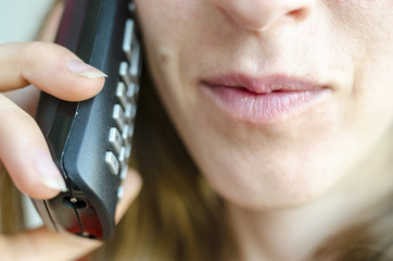 Woman talking on telephone