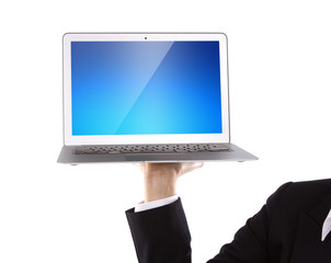 Business person holding an open laptop isolated on white backgro