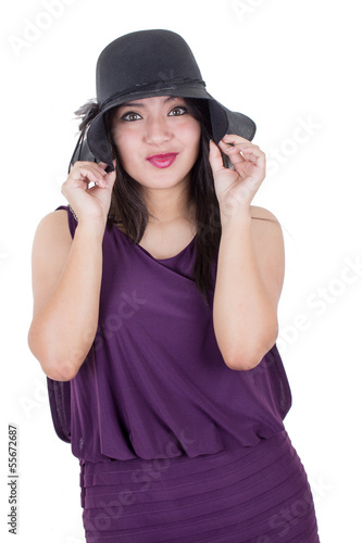 Beautiful hispanic girl wearing a hat smiling isolated on white
