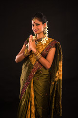 traditional indian female greeting with dark background
