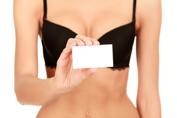 Woman in black bra holds an empty white card