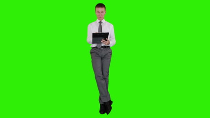 Young businessman writting on a clipboard, Green Screen