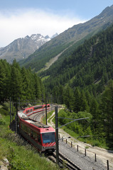 Glacier Express train near Zermatt in Swiss Alps