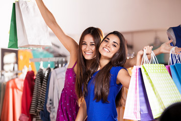 Happy female friends shopping