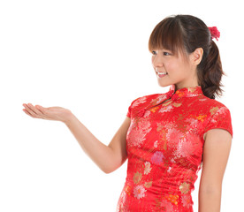 Chinese cheongsam girl showing empty palm