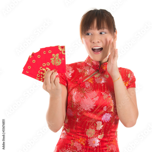 Surprise Chinese cheongsam girl holding red packets