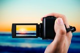 Video camera or camcorder recording sunset
