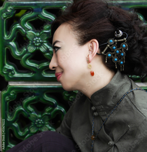 Side view wearing traditional Chinese clothing qipao woman