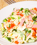 fresh salad with cheese, ham and vegetables
