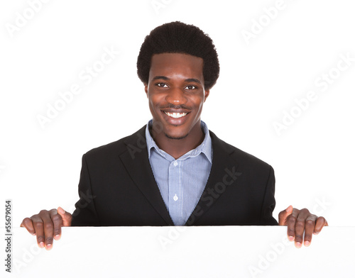 African Businessman With Placard