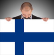Smiling businessman holding a big card, flag of Finland