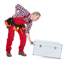 Man Technician With Back Pain Lifting Metal Box