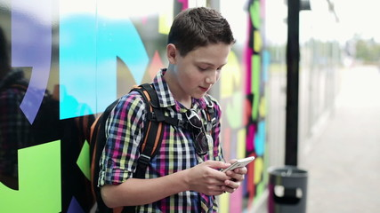 Young teenager with smartphone in the city
