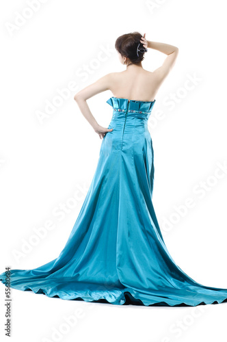 beautiful fashion model posing in blue evening dress back