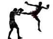 two men exercising thai boxing silhouette