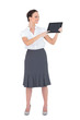 Cheerful businesswoman showing something on her tablet pc