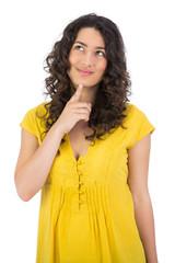 Pensive casual young woman posing