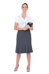 Cheerful businesswoman holding datebook