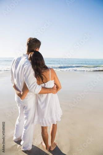 Content couple looking at the waves