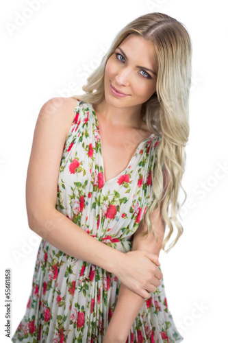 Relaxed seductive blonde wearing flowered dress posing