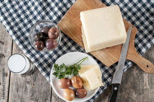 Delicious Cheese and olives on table