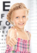 girl with optical eye chart