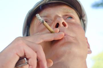 Thoughtful middle-aged man smoking