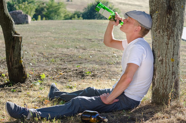 Alcoholic drinking alone in the countryside