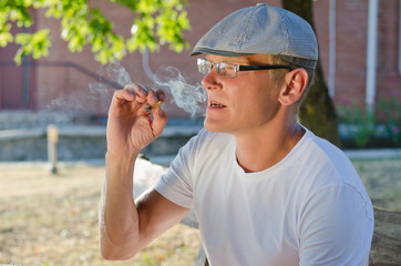 Man smoking a cigarette or joint