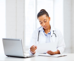 female doctor with laptop pc