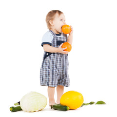toddler with vegetables eating orange