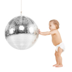 toddler playing with disco ball