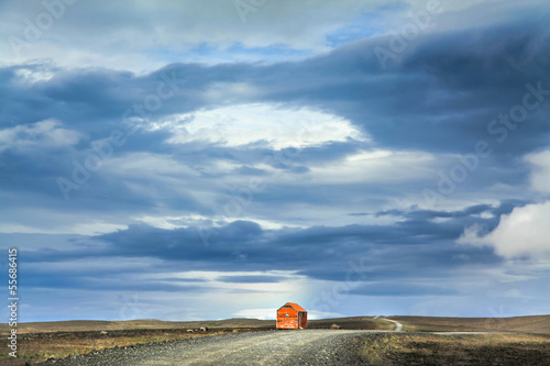 Barren landscape with old snowstorm shelter in Iceland