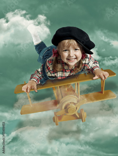 portrait of a little girl on an airplane abstract