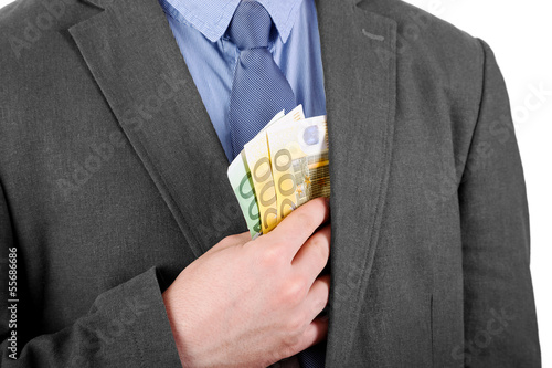 Hand is putting money into Jacket
