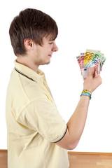 Young man shows his joy bills
