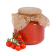 Tomato sauce in a glass jar and fresh tomatoes isolated