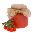 Ketchup and a branch of ripe tomatoes isolated on white