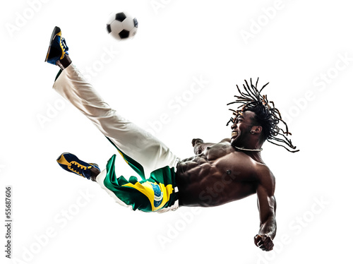 brazilian  black man soccer player kicking football