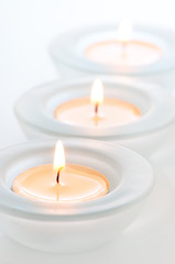 three tealights with reflections