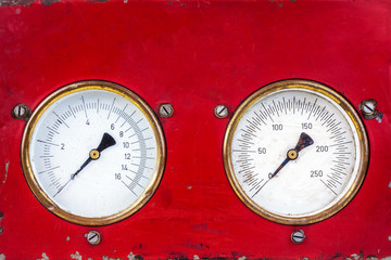 Old red industry panel with two analog meters